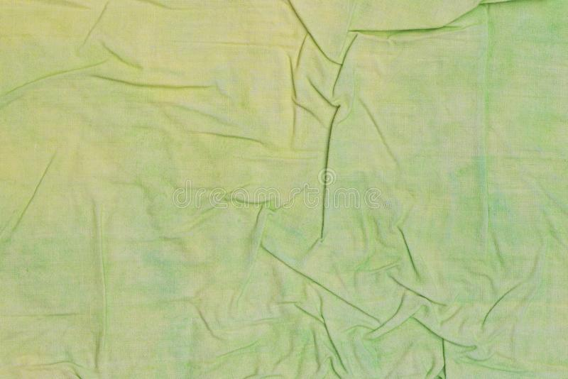 Green and yellow creased painted textile background. Green and yellow  color painted textile background royalty free stock photo