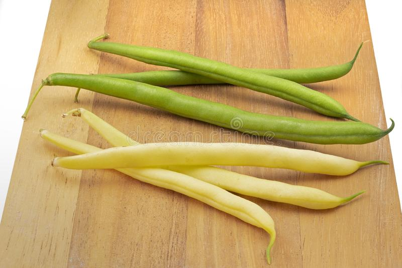 Fresh beans on a wooden board stock photography