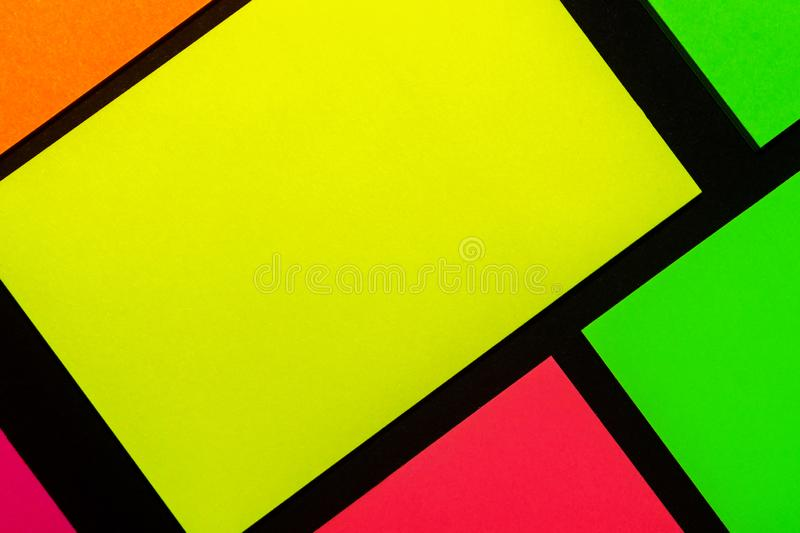 Green, yellow, orange and rose hue colorful office stickers on black paper. Office noteparer as reminder. Isolated on black paper. Green, yellow, orange and stock photography