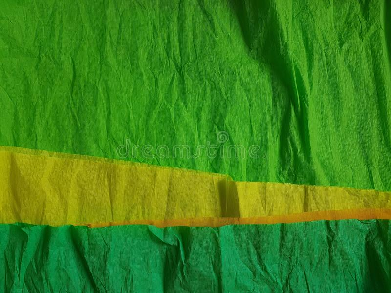 Green yellow paper background silk surface empty blank sheets vivid colors. Yellow green paper background silk surface empty blank sheets vivid colors wrapping royalty free stock photo