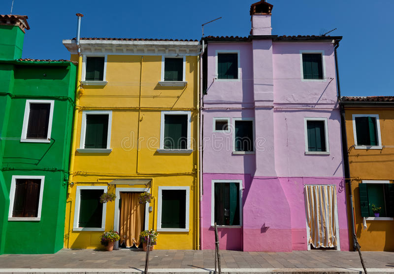 Green, yellow, purple and brown houses in Burano, Venice, Italy royalty free stock image