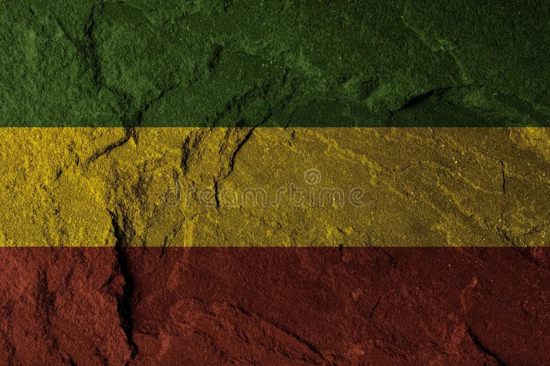 Green yellow red on stone wall, reggae background concept stock photography