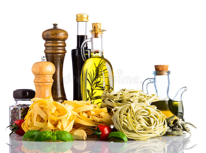 Green and Yellow Tagliatelle Pasta with Italian cuisine on white stock images