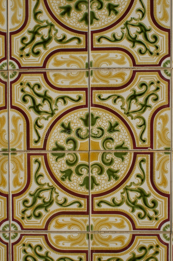 Green and yellow tiles. Green and Yellow Azulejo on a building in Porto stock photos