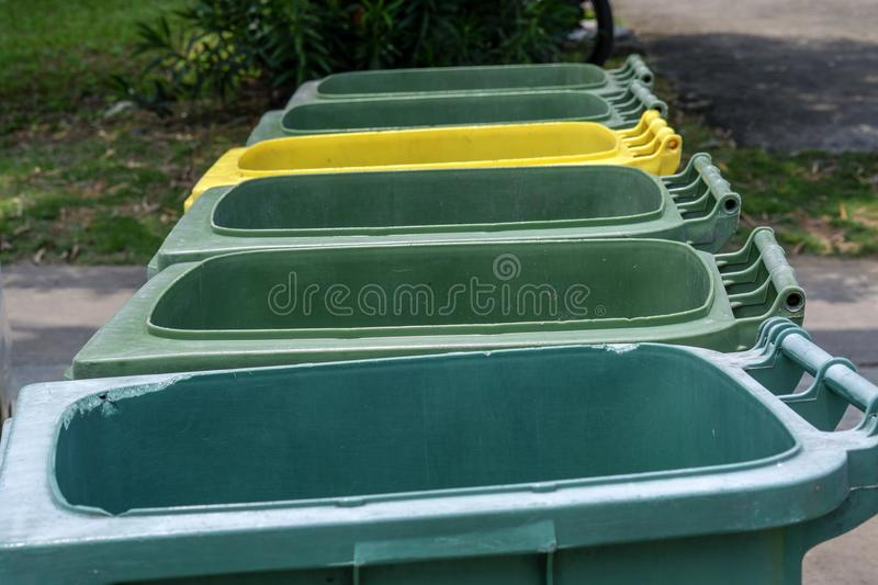 Green and yellow trash bin royalty free stock photography