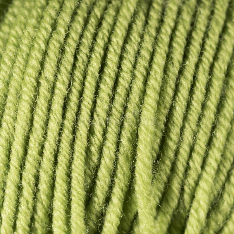 Green yellow wool thread ball macro closeup stock photography