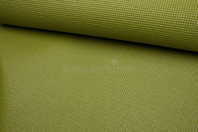 Green Yoga Exercise Mat Stock Photo