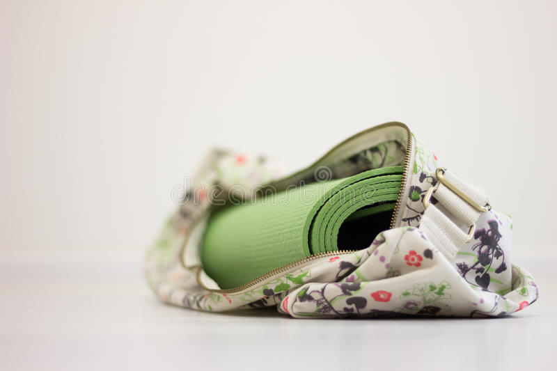 Green yoga mat in the bag. Photo royalty free stock images
