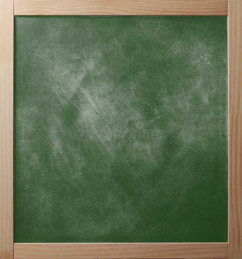Greenboard da escola no quadro de madeira fotos de stock royalty free