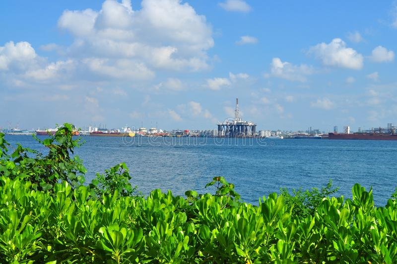 Greenery With Industrial Areas Separated By Water Stock Photography
