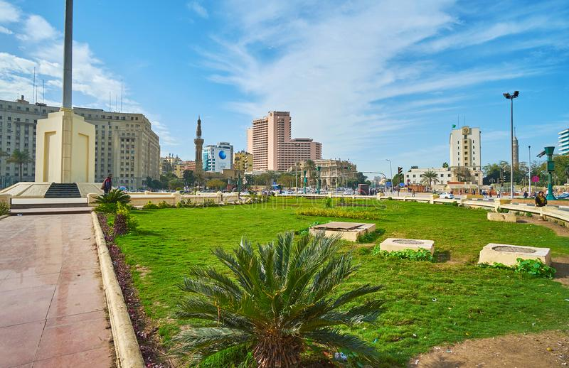 Greenery on Midan Tahrir Square, Cairo, Egypt. CAIRO, EGYPT - DECEMBER 24, 2017: The green lawn around the national flag amid Midan Al Tahrir - one of central stock image