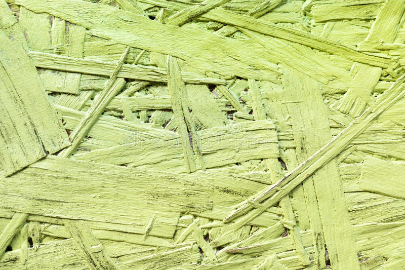 Greenery painted wood chipboard texture background. Close up stock photos