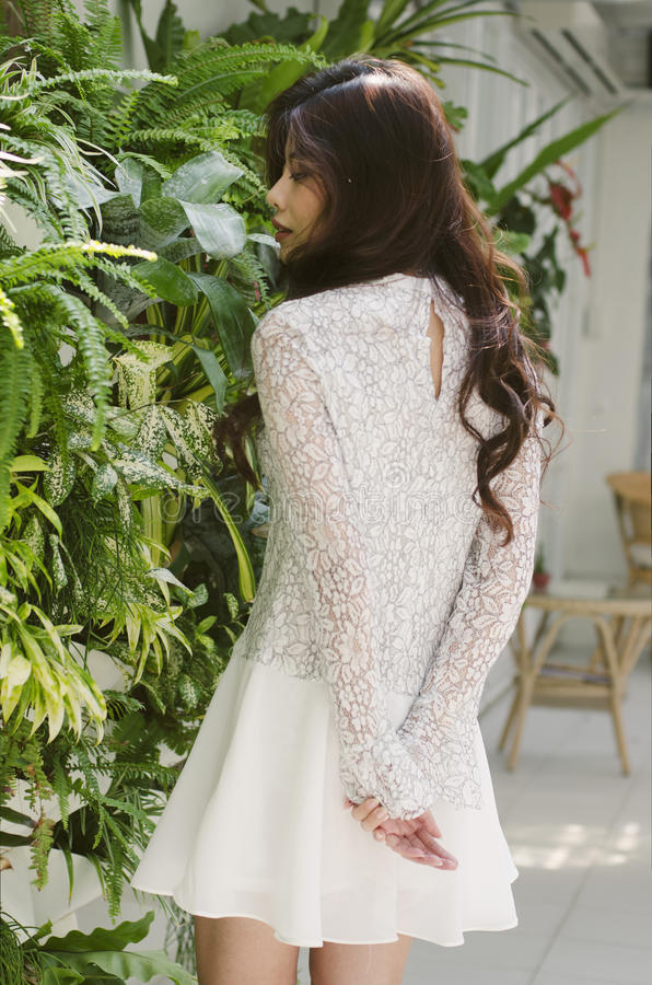 Greenery wall and white dress royalty free stock images