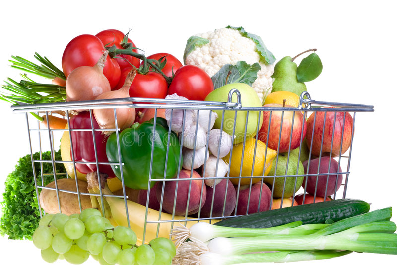 Greengrocery basket. Metal basket with fruits and vegetables royalty free stock images