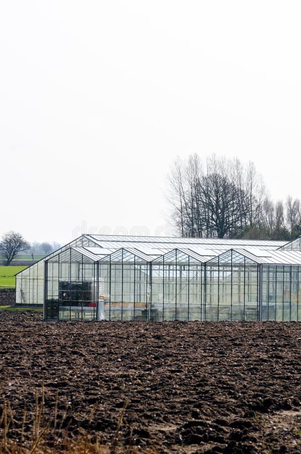 Greenhouse on a field royalty free stock photo