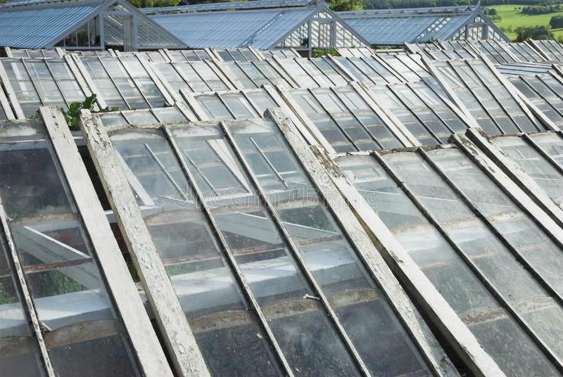 Greenhouse Glass Sheets. Glass sheets for garden cold frames to protect plants from frost in Winter stock image