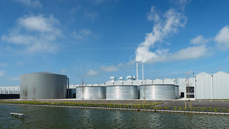 Greenhouse with storage tanks infront - netherlands royalty free stock photography