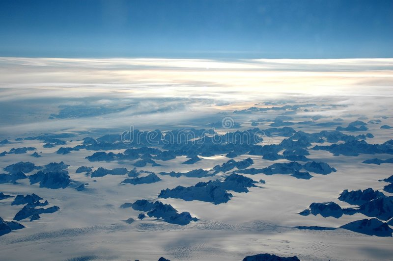 Greenland. View out of a plane on snow landscape royalty free stock photography