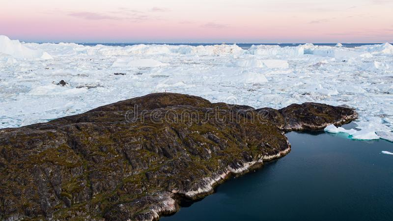 Greenland. Arctic nature landscape with icebergs in icefjord aerial drone video. Greenland. Arctic nature landscape with icebergs in Greenland icefjord. Aerial royalty free stock images
