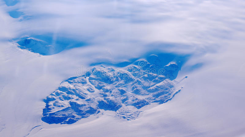 Greenland as seen from the sky, wing view with airplane turbine. Greenland as seen from the sky out of an airplane royalty free stock photos