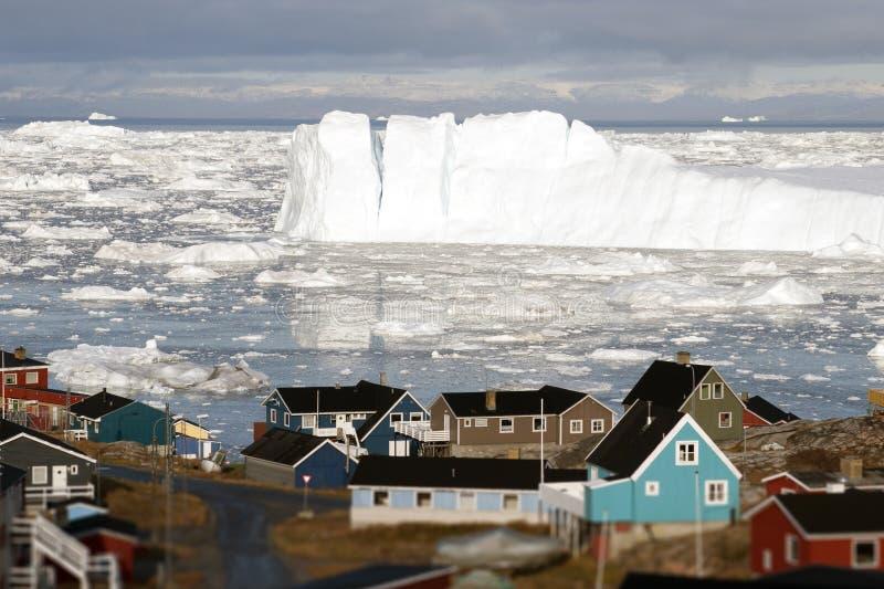 Greenland glacier glaciers houses ocean small town burg sky. Arctic royalty free stock photo