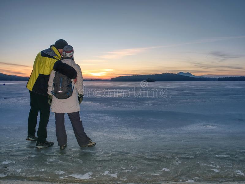 Greenland hiking travel tourist lovers with hold hands royalty free stock photography