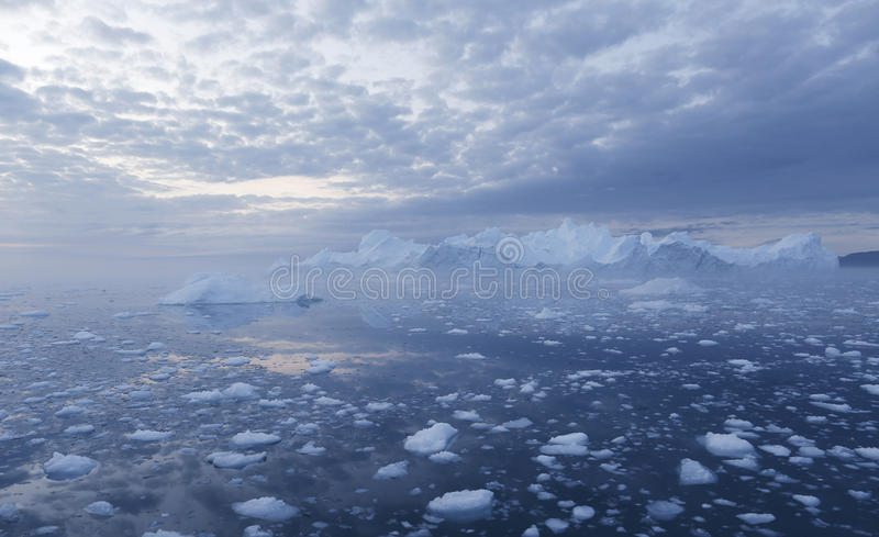 Greenland. Nature and landscapes of Greenland.Travel on the scientific vessel among ices. Studying of a phenomenon of global warming. Ices and icebergs of royalty free stock photo