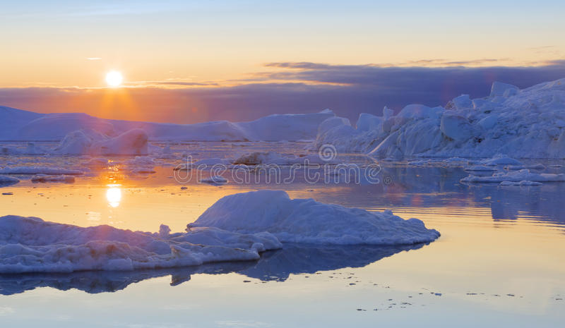 Greenland. Nature and landscapes of Greenland.Travel on the scientific vessel among ices. Studying of a phenomenon of global warming. Ices and icebergs of stock photos