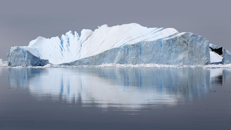 Greenland. Nature and landscapes of Greenland.Travel on the scientific vessel among ices. Studying of a phenomenon of global warming. Ices and icebergs of royalty free stock photography