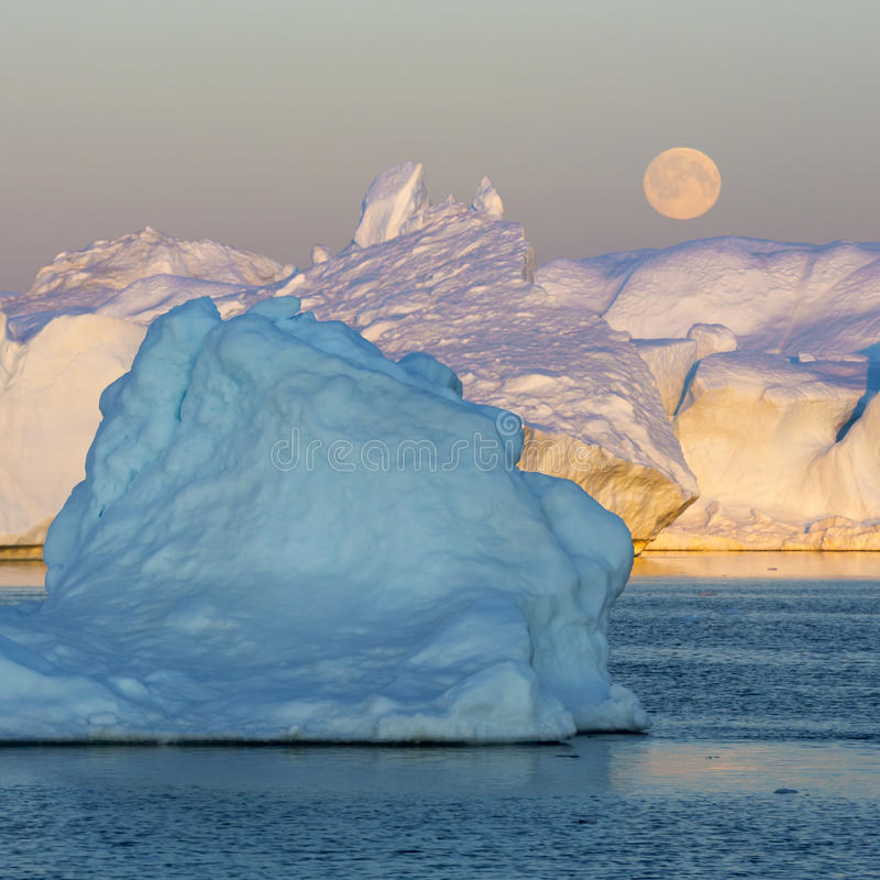 Greenland. Nature and landscapes of Greenland. Travel on the scientific vessel among ices. Studying of a phenomenon of global warming. Ices and icebergs of stock image