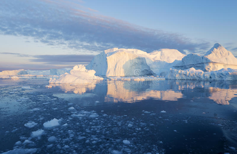 Greenland. Nature and landscapes of Greenland. Travel on the scientific vessel among ices. Studying of a phenomenon of global warming. Ices and icebergs of stock photography