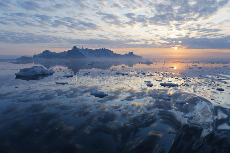 Greenland. Nature and landscapes of Greenland. Travel on the scientific vessel among ices. Studying of a phenomenon of global warming. Ices and icebergs of stock images