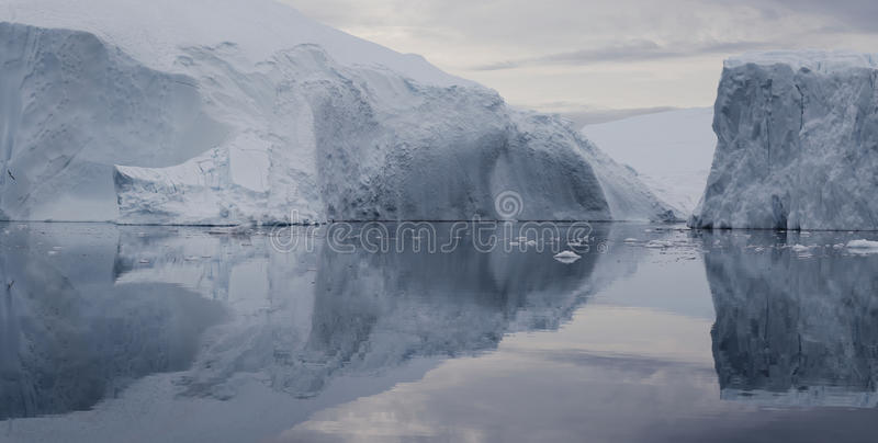 Greenland. Nature and landscapes of Greenland. Travel on the scientific vessel among ices. Studying of a phenomenon of global warming. Ices and icebergs of stock photo