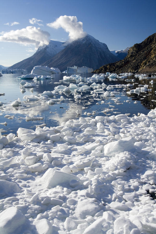 Greenland - Northwest Fjord - Scoresbysund. Ice on the shore of a small inlet in Northwest Fjord in the far reaches of Scoresbysund in eastern Greenland stock photo