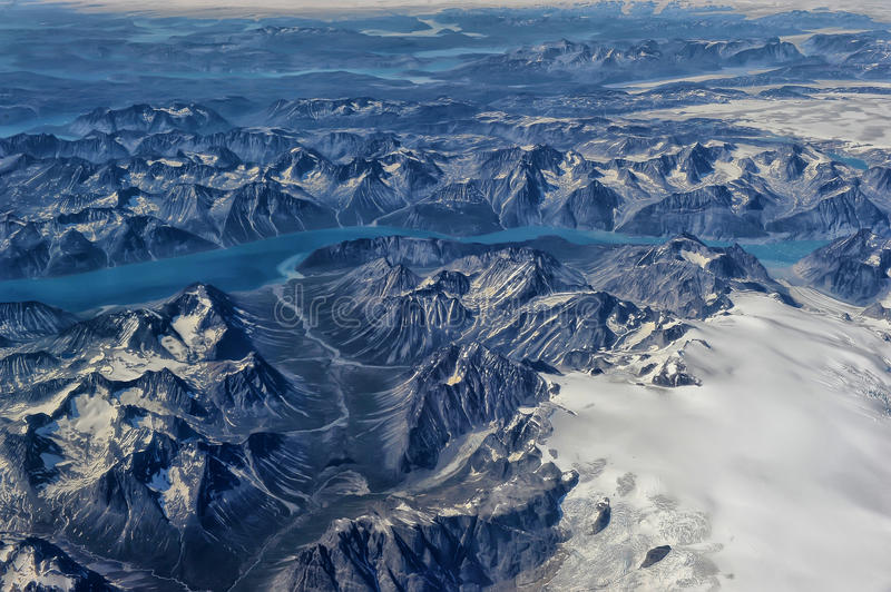 Greenland. From the plane window stock photography
