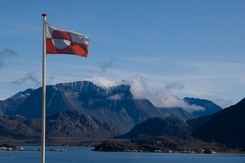 Greenland shoreline with flag stock image