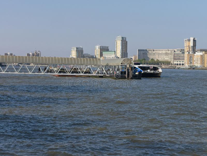 Greenland Surrey Quays Pier in the River Thames with Canary Wharf Skyline in the background royalty free stock photos