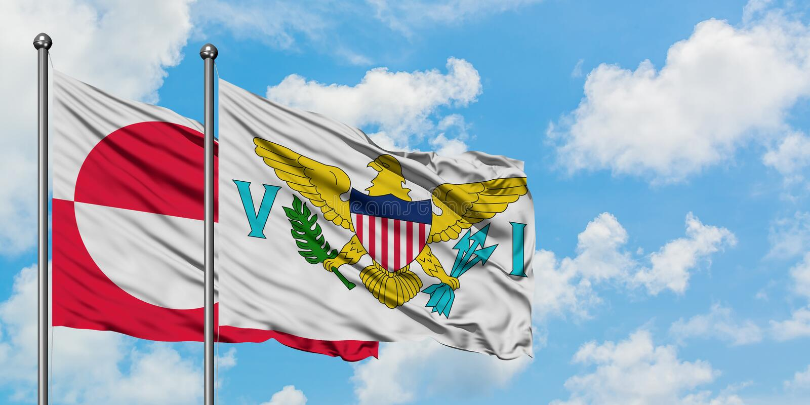 Greenland and United States Virgin Islands flag waving in the wind against white cloudy blue sky together. Diplomacy concept,. Waving in the wind against white royalty free stock image