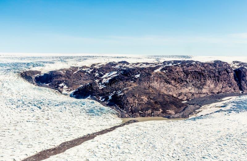 Greenlandic melting ice sheet glacier aerial view from the plane, near Kangerlussuaq, Greenland stock photos