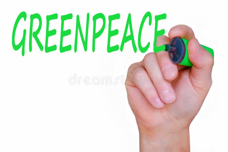 Greenpeace lettering, handwriting marker on the glass. The concept of environmental conservation. Respect for nature royalty free stock images
