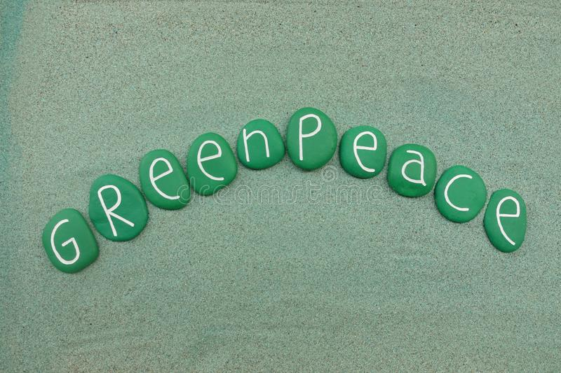 Greenpeace, non-governmental environmental organization text withgreen stones. Celebration of the non governamental enviromental oraganization born in Amsterdam royalty free stock photography