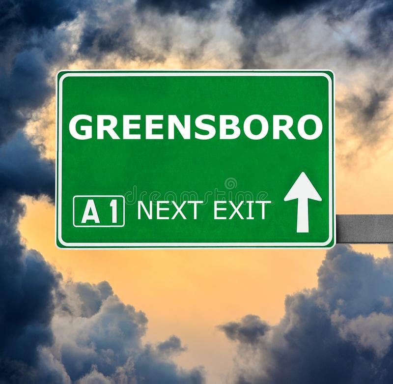 GREENSBORO road sign against clear blue sky stock images