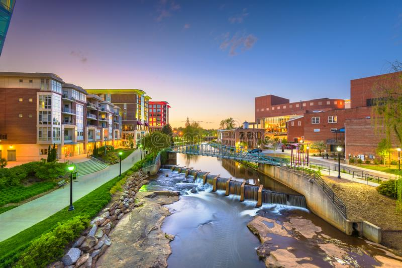 Greenville, South Carolina, USA downtown cityscape on the Reedy River. At dusk stock image