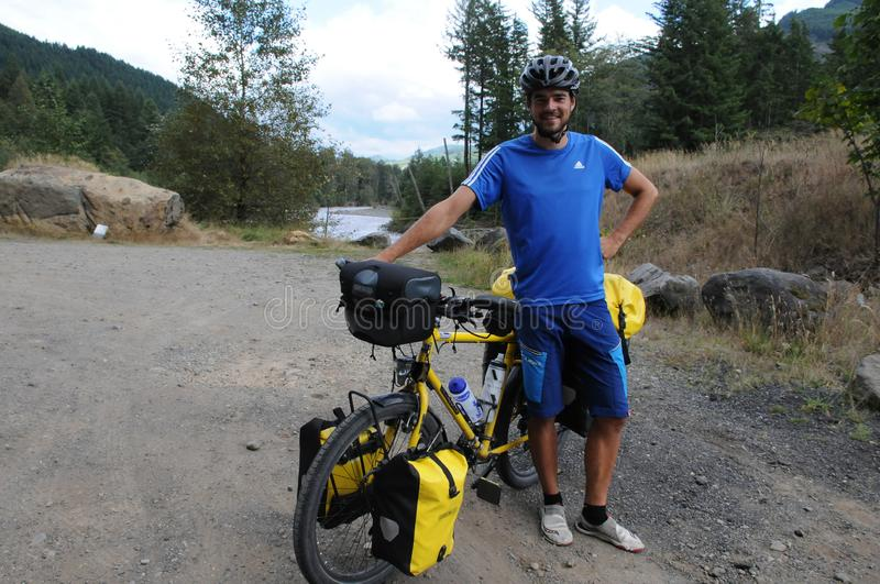 German biker from munchen Simon Piwowarsky in USA. GREENWATER RIVER /NEAR ENUMCLAW / WASHINGTON / USA./  SImon Piwowarsky short for Piwo riding bike on the dedge stock photos
