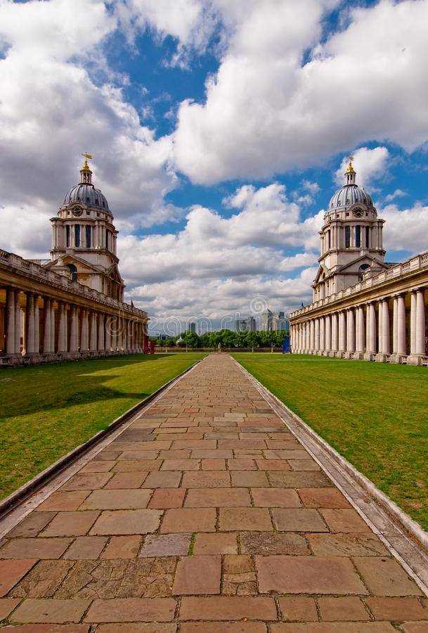 Greenwich Maritime College. The Greenwich Maritime College in England with a distant view of Canary Warf royalty free stock photos