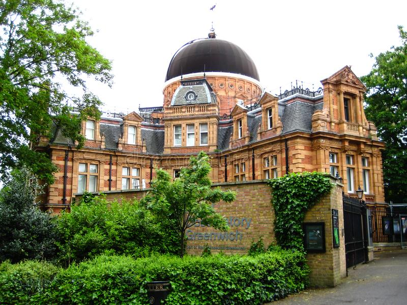 Greenwich observatory with beautiful green grass and clouds land royalty free stock images