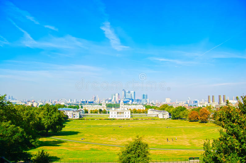 Greenwich Park, Maritime Museum and London skyline on background. Greenwich Park, National Maritime Museum, Canary Wharf skyscrapers and London skyline on stock photography