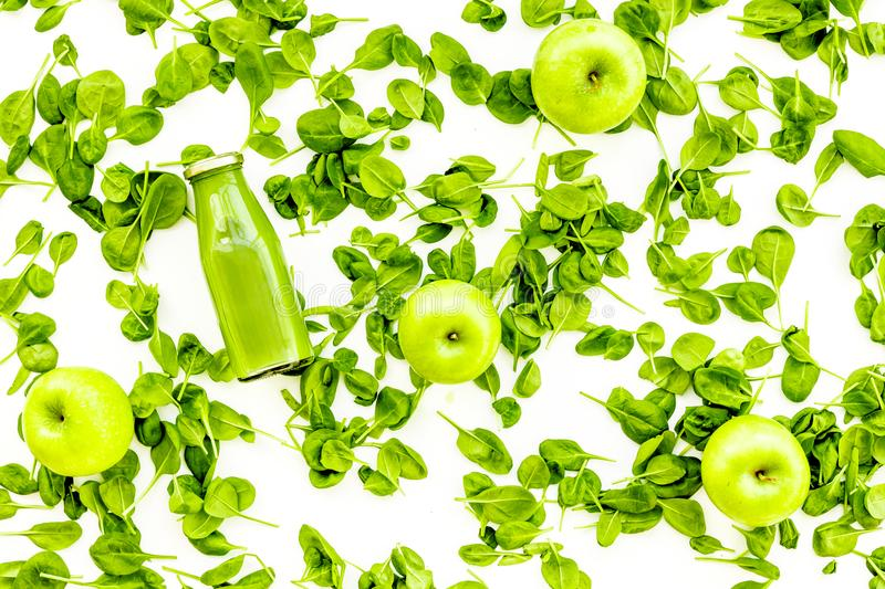 Greeny vegetable smoothie in bottle with apples on white background top view mock up royalty free stock image