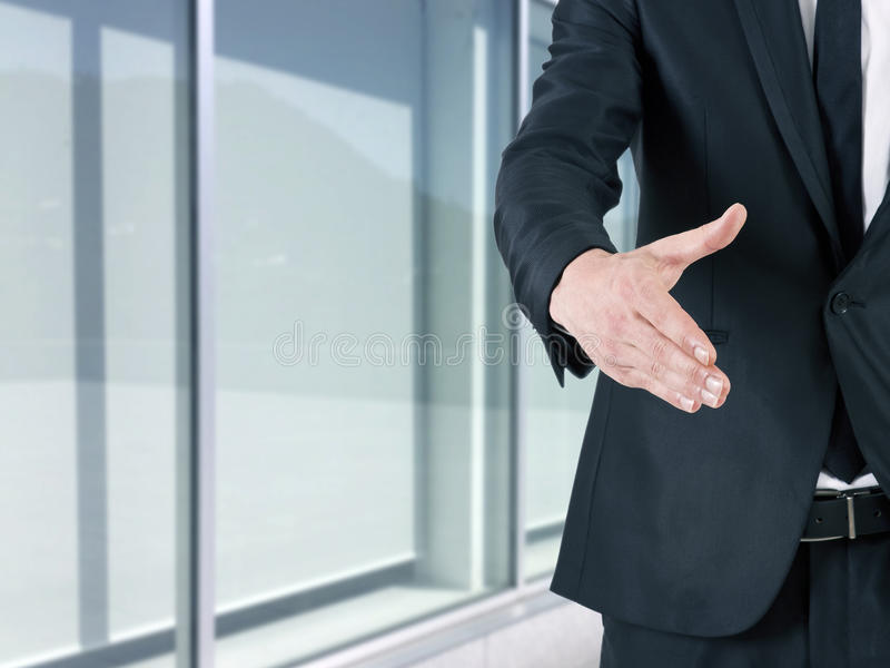 Greeting. Businessman offering hand waving,greeting royalty free stock photography