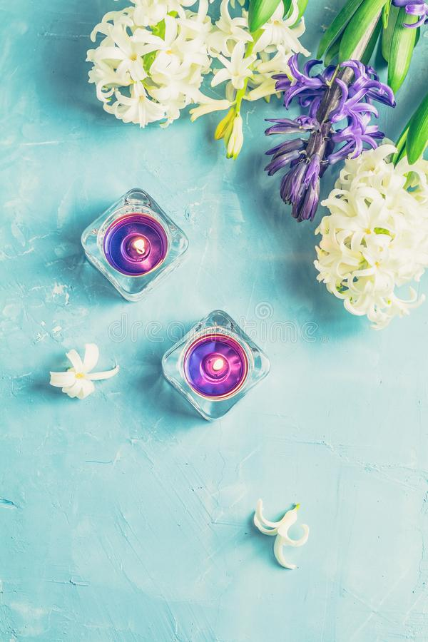 Greeting card with blue candles and hyacinths stock photo